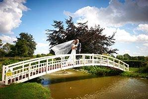 Completed Bridge in White, with Wedding Couple